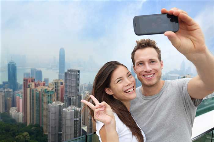 Hong Kong holiday couple taking a selfi