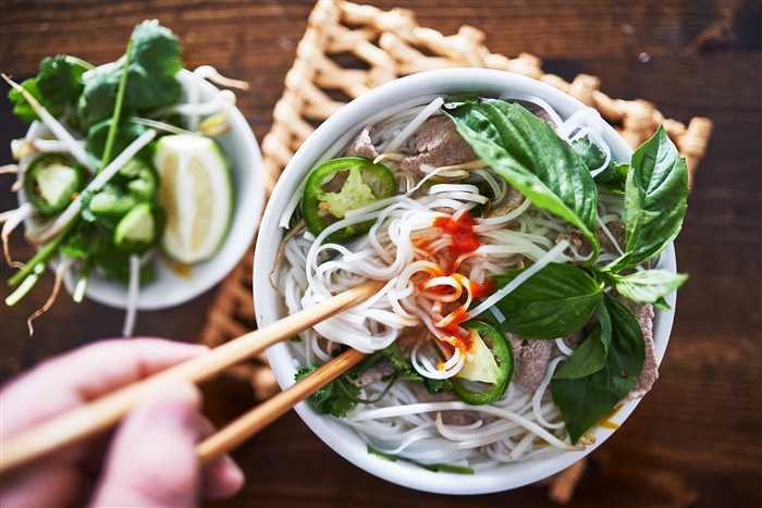vietnamese pho with spicy sriracha sauce