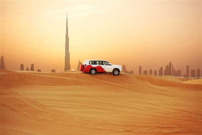 Arabian Desert at sunset with Dubai skyline