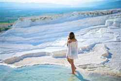 Pamukkale (Cotton Castle) Is Popular With Travertine Pools And Terraces. Tourist Flock In Pamukkale For This Attraction In Turkey,