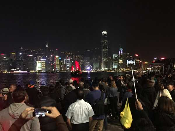 People gathering to watch symphony of lights Hong Kong